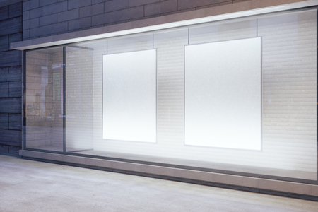 Blank white posters in the window on night empty city street, mock up Stok Fotoğraf