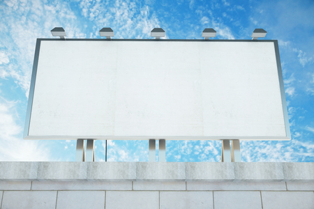 billboard advertising: Blank billboard on the roof of building at blue sky background, mock up