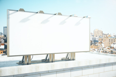 the place is outdoor: Blank billboard on the roof of building at megapolis city background, mock up