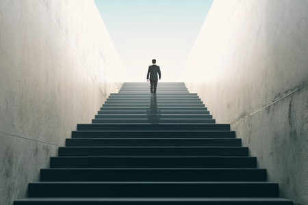 business project: Ambitions concept with businessman climbing stairs Stock Photo