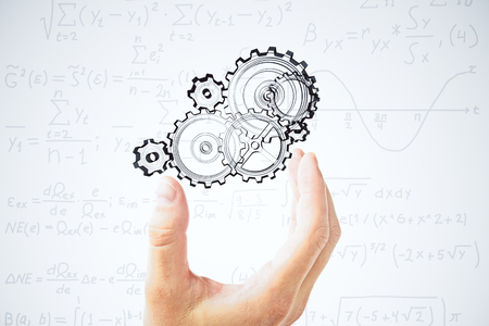 equations: Human hand and painted gears at equations background Stock Photo