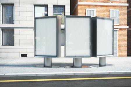 city of sunrise: Blank white billboards on city street at sunrise, mock up