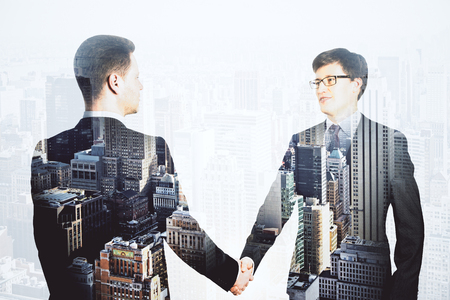 disctrict: Double explosure with businessmen shake hands and financial city disctrict