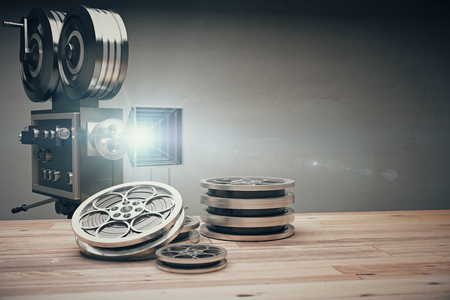 movie reel: Vintage old movie camera and film cartridge on a wooden table
