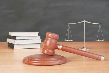 litigation: litigation inventory with gavel, books and scales on wooden table at blackboard background