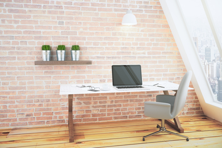 brick floor: Blank black laptop screen on white wooden table in loft room with brick wall and city view