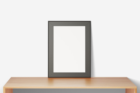 Blank picture frame on a wooden table, mock up