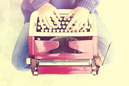 Hipster girl with old style typewriter