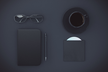 diary cover: Blank black diary cover with cup of coffee, eyeglasses and CD disk on black table, mock up