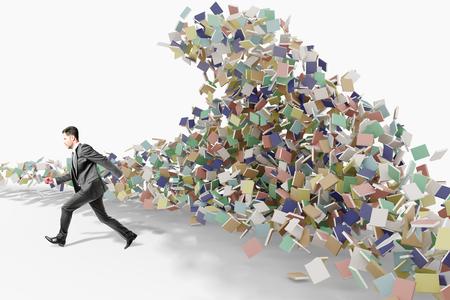 Man runs away from tsunami waves consisting of books, education concept Banco de Imagens