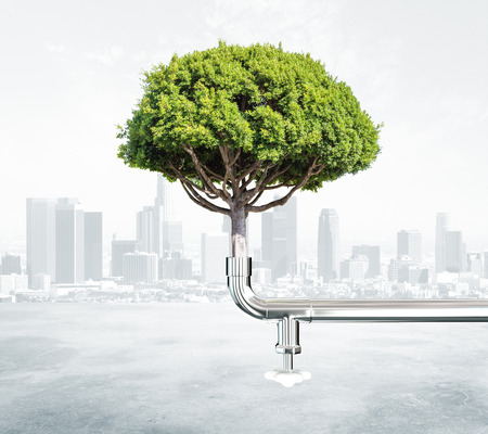 water concept: Green energy concept with tree and water tap at city background