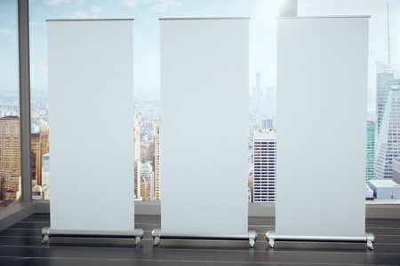 megapolis: Blank white posters on black wooden floor and glassy walls with megapolis city view, mock up