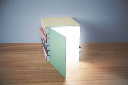opened book: Knowledge concept with opened book with glowing pages and pile of books behind on wooden table