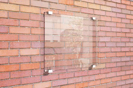 mocked: Transparent signboard on red brick wall, mock up