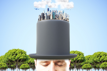 megapolis: Man in black cylinder with 3D megapolis city on the top at blue sky background