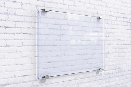 mocked: Blank glassy sighnboard on white brick wall, mock up Stock Photo