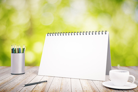 diary book: Blank diary cover on wooden table with pencils and cup of coffee, mock up Stock Photo