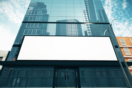Blank billboard on glassy wall of business center, mock up, 3D Render Stock Photo