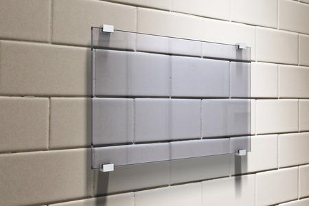 mocked: Glassy signboard on beige brick wall, mock up, 3D Render