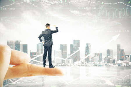 finger tip: Research concept with businessman standing on finger tip, looking into the distance on digital city background