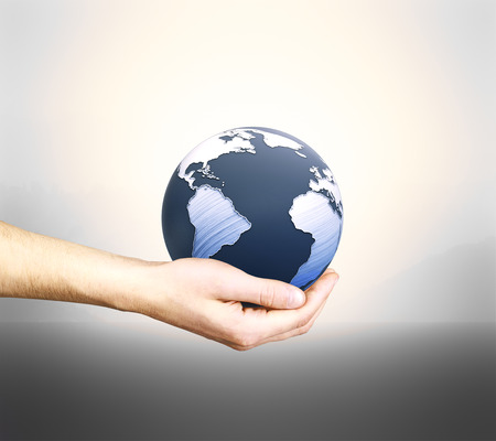 globe  the terrestrial ball: Male hand holding 3D rendered terrestrial globe on grey background Stock Photo