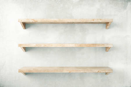 estanterias: estantes vacíos en el fondo muro de hormigón. Maqueta, 3d