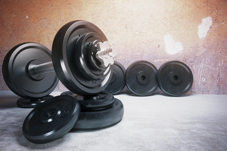 lb: Dumbbell and row of plates on concrete floor. 3D Render