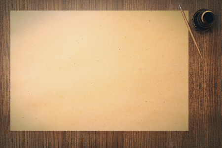 inkpot: Topview of blank aged paper sheet and ink-pot on wooden table. Mock up, 3D Render