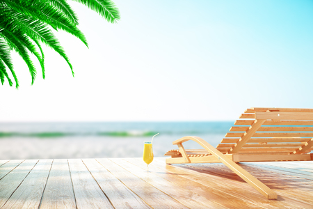 longue: Chaise longue and cocktail at the beach with clear sky and palm tree Stock Photo