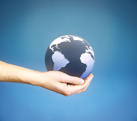 globe  the terrestrial ball: Male hand holding 3D rendered terrestrial globe on blue background