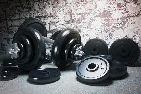 Dumbbell and plates on concrete floor and brick wall. 3D Render Imagens