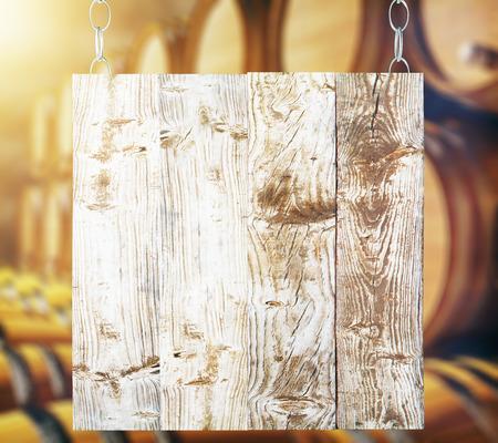 bill board: Blank wooden board with barrels in the background. Mock up, 3D Rendering