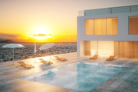 3d swimming pool: Luxurious hotel exterior with swimming pool at sunset. 3D Rendering Stock Photo