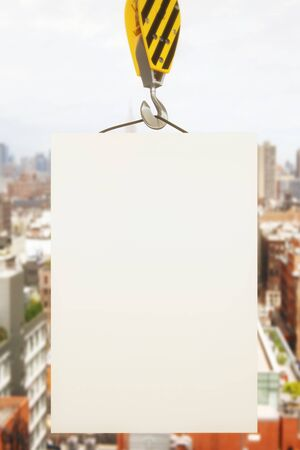 hook up: Blank poster on crane hook with cityscape in the background. Mock up, 3D Rendering