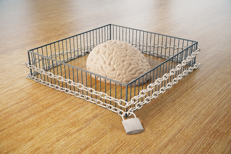 Lack of free thinking concept with brain locked in cage with chains on wooden surface. 3D Rendering