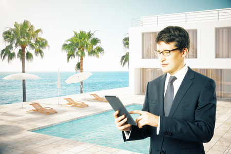 hotel exterior: Businessman in front of hotel exterior with swimming pool. 3D Rendering