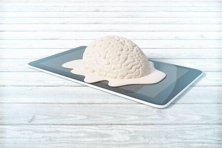 degradation: Mental degradation concept with brain melting on tablet placed on light wooden desktop. 3D Rendering
