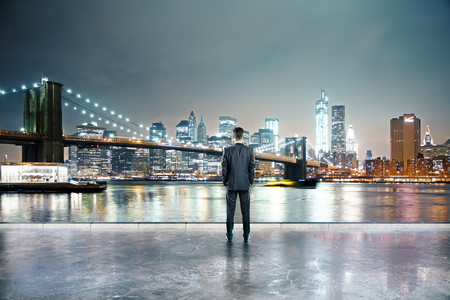 rearview: Rearview of businessman in illuminated night city Stock Photo