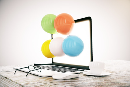 laptop outside: Desktop with balloons coming out of laptop screen and other items on grey background. Abstract concept, 3D Rendering Stock Photo