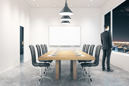 board room: Conference room interior with blank board, businessman and city view at night. Mock up, 3D Rendering