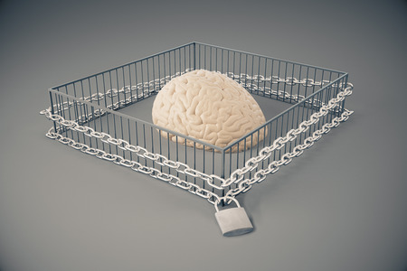 ideology: Lack of free thinking concept with brain locked in cage with chains on dark grey background. 3D Rendering Stock Photo