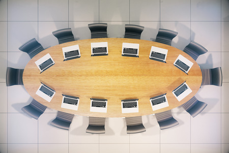 conference table: Topview of wooden conference table with laptops. 3D Rendering