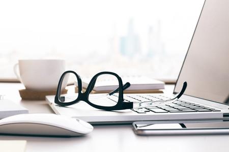 Closeup of glasses on laptop keyboard