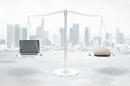 grey scale: Balance scale with brain and laptop on grey city background. 3D Rendering