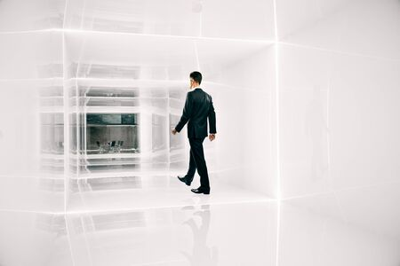corridor: Businessman walking towards office throught bright corridor. 3D Rendering