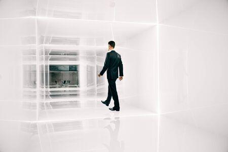 businessman walking: Businessman walking towards office throught bright corridor. 3D Rendering