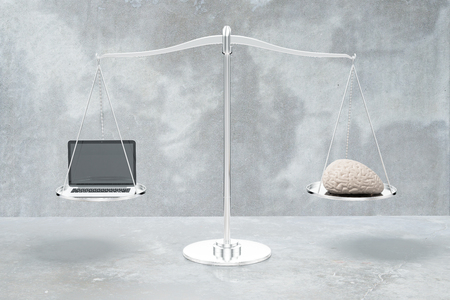 grey scale: Balance scale with brain and laptop on grey concrete background. 3D Rendering