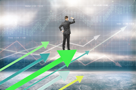 green arrows: Research concept with businessman on green arrows and forex background