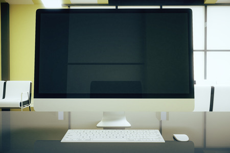 blank computer screen: Closeup of blank computer screen on office desk. Mock up, 3D Rendering