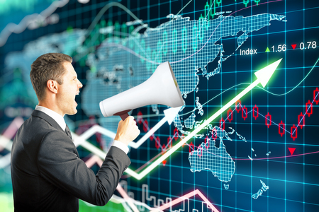 businessman using a megaphone: Businessman screaming into a megaphone on forex background Stock Photo